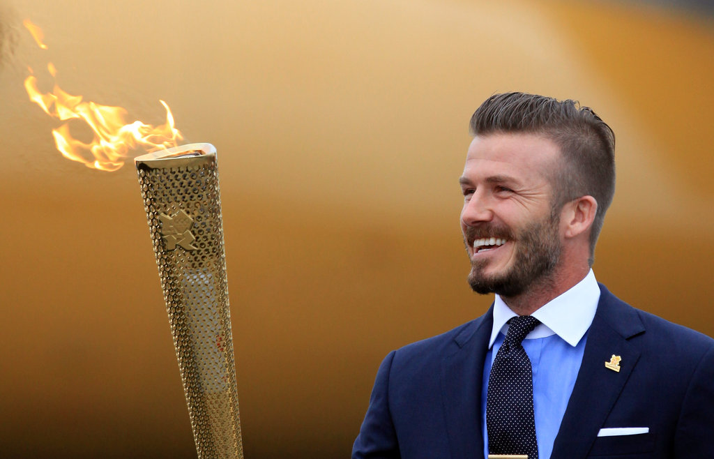 David Beckham Brings the Olympic Flame to England