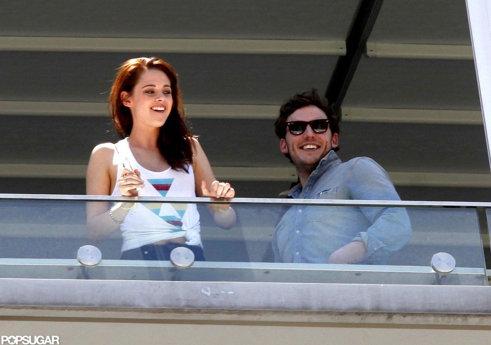 Kristen Stewart and Sam Claflin hung out on the balcony of their hotel.