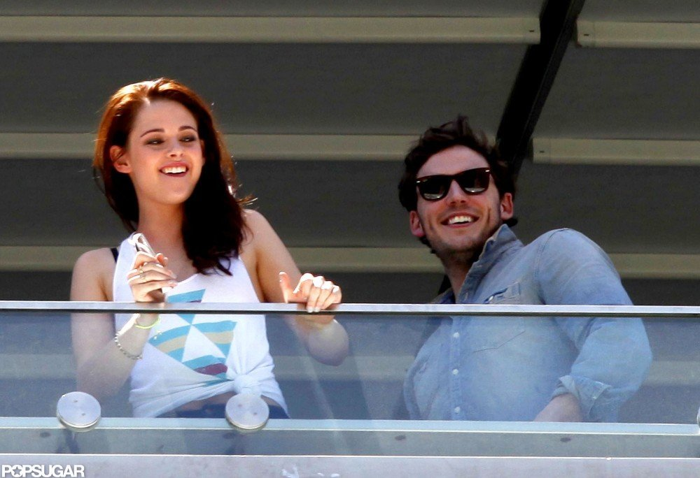 Kristen Stewart and Sam Claflin smiled big.