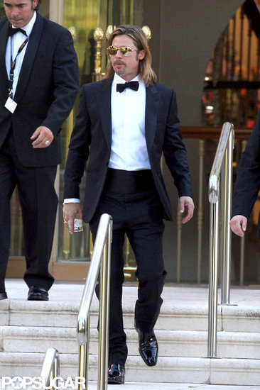 Brad Pitt Lets Loose in Cannes With a Drink in Hand