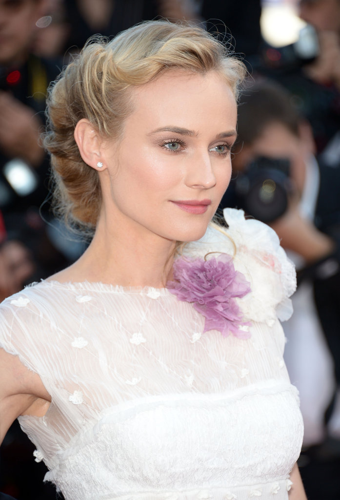 Diane Kruger wore a pretty floral boutonniere at the neckline of her ethereal white gown.