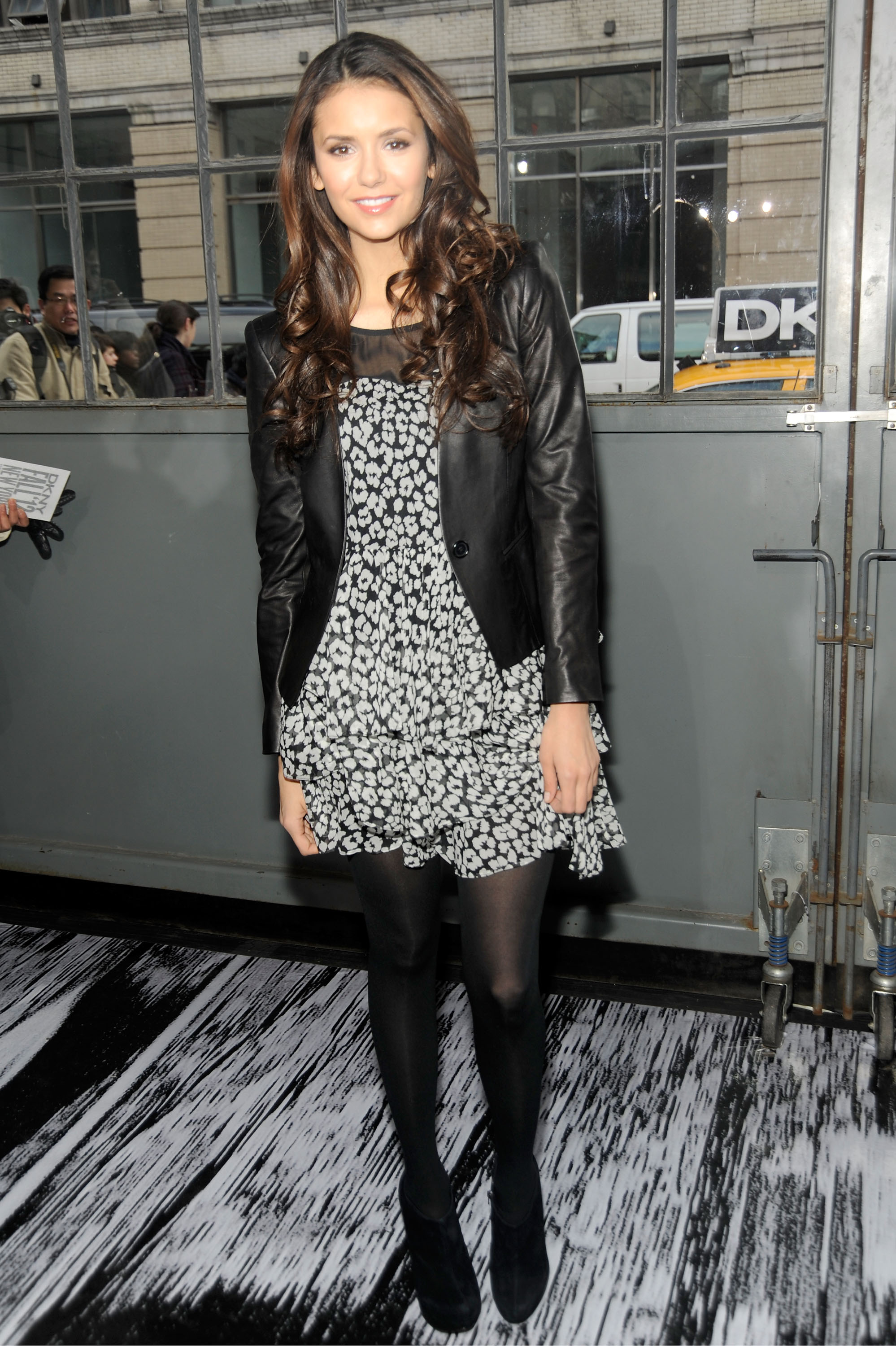 She nailed the cool-girl look in a floral DKNY frock and tougher leather jacket at the brand's Fall 2012 runway show.