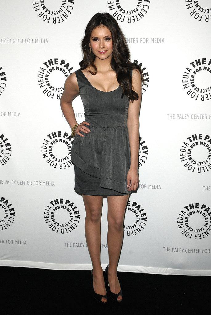 Nina is able to easily transition into supersophisticated looks. Case in point: this chic grey sheath styled with peep-toe pumps she wore to Paley Fest in 2010.