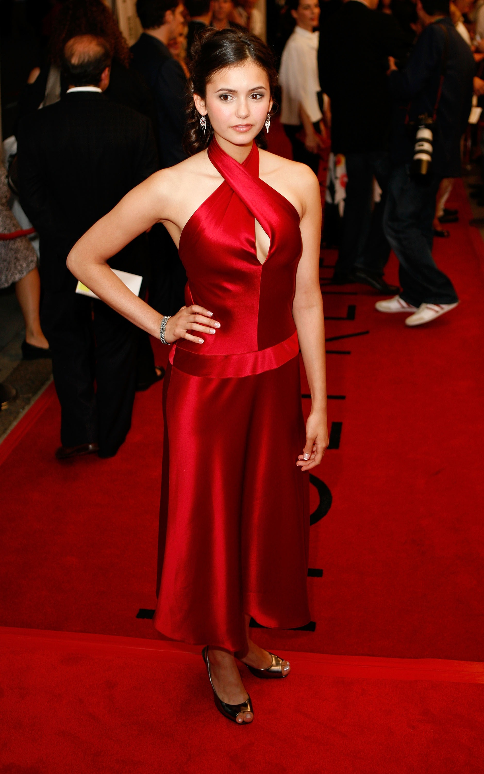 Nina chose a silky red halter dress for a gala in September 2007.