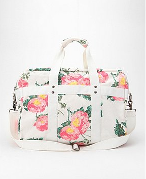 We're smitten with the fresh floral-on-white print. Whether you're grabbing it for a weekend getaway, stashing your stuff for a day at the beach, or heading off to the gym, this style is sure to illicit lots of complements.  Kimchi Blue Floral Patch Weekender Bag ($59)