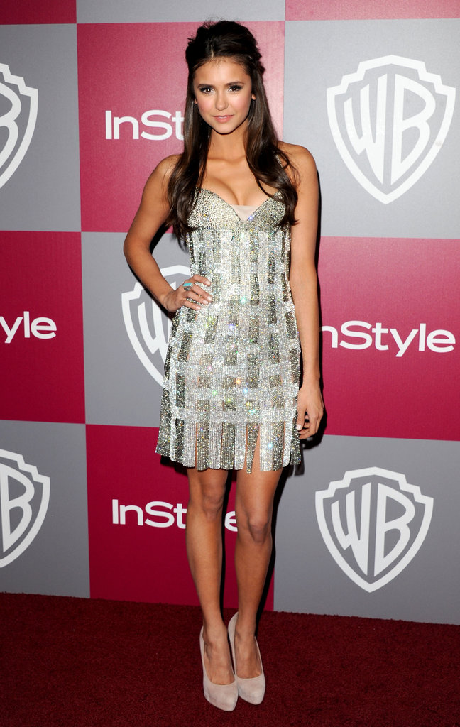 She sparkled in a Georges Chakra Couture strapless frock with nude pumps at the 2011 InStyle/Warner Bros. Golden Globes party.