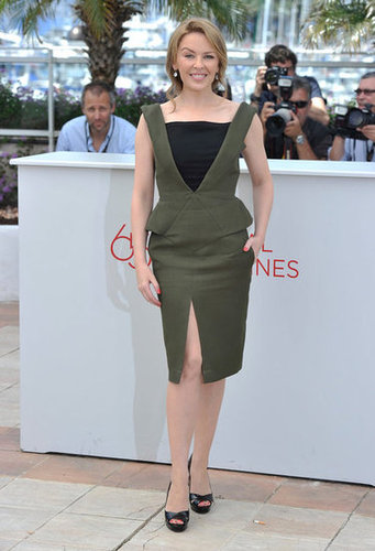 For the Holy Motors photocall, Kylie Minogue chose a peplum, front-slit Emilio Pucci number to go with her peep-toe slingback pumps.