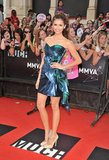 We're loving Nina's iridescent emerald-green strapless dress — with an asymmetric bow, no less — by Georges Chakra Couture at the 2011 MuchMusic Video Awards.