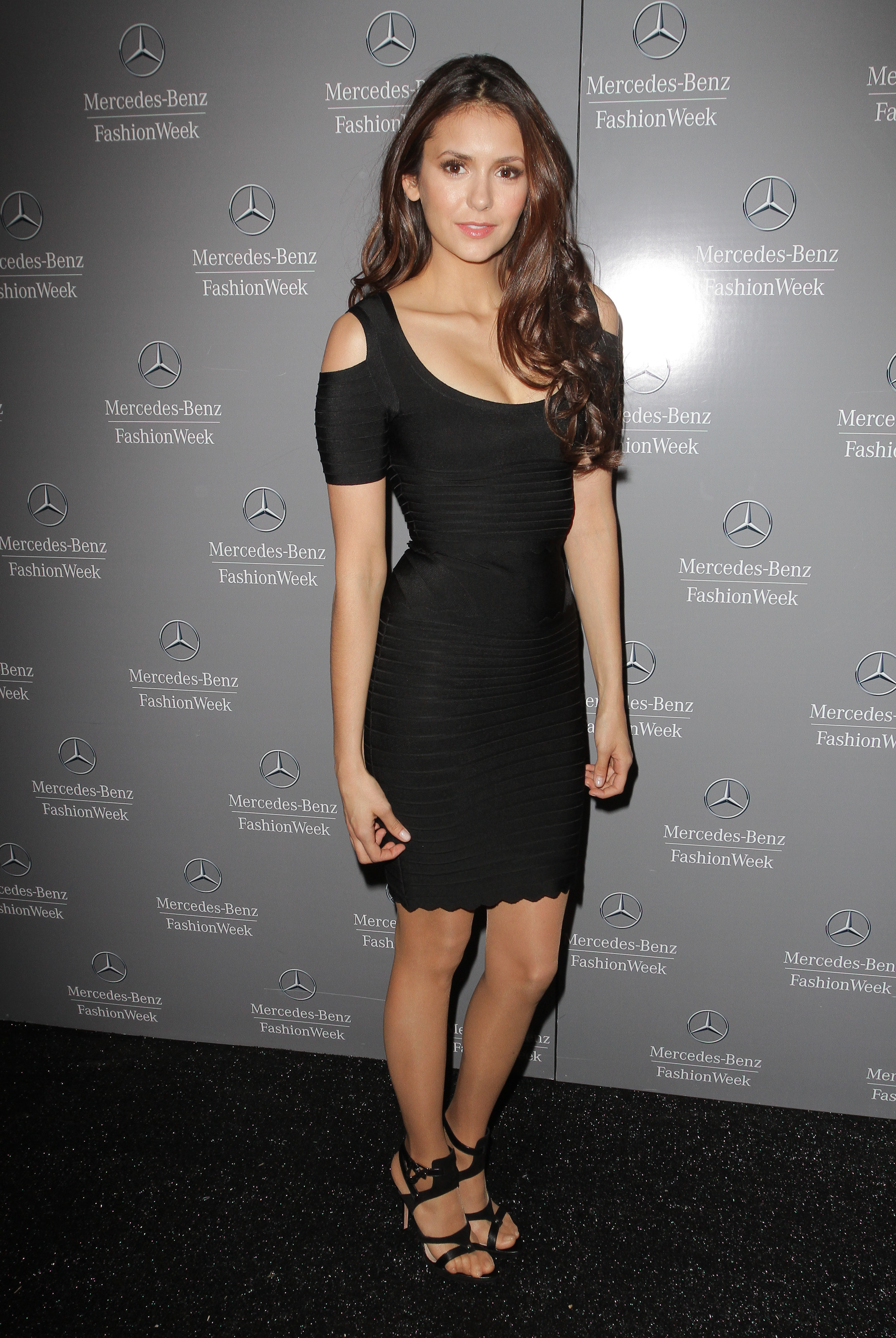 The starlet showed a bit of skin via shoulder cutouts in this LBD at Fall 2012 New York Fashion Week.