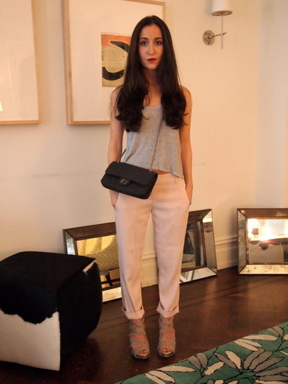 Silk Pale pink pants, toughed up with a chain strap bag and burgundy lipstick. 