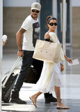 Eva Longoria and Eduardo Cruz both sported shades while walking through a train station in Spain.