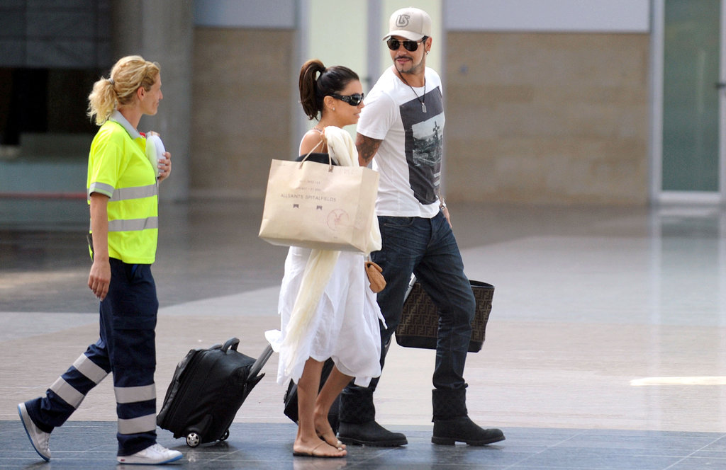 Eva Longoria and Eduardo Cruz walked through a train station in Spain together.