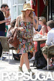 Sienna Miller looked cute in a floral dress that showed off her baby bump.