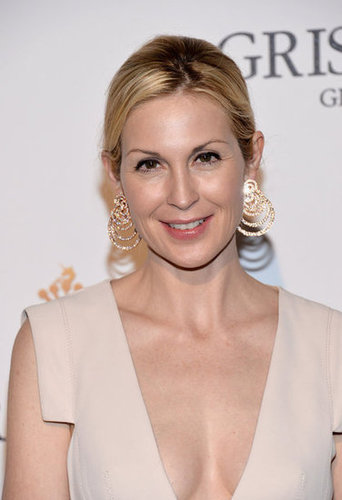 Kelly Rutherford accessorized her creamy gown with megawatt gold earrings.