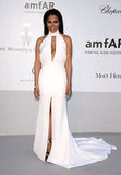 Janet Jackson wore a white halter-neck Emilio Pucci dress with more than a couple jawdropping slits.