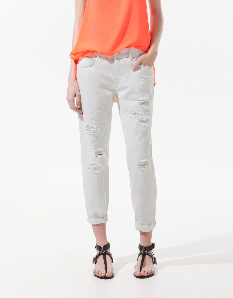 White denim is a good Summer staple to have in any capacity, but there's something about this slouchy, cuffed pair that has us hooked.  Zara Damages Denim ($80)