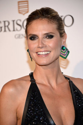 Check out those statement earrings on Heidi — the emerald hue offsets her black gown perfectly.