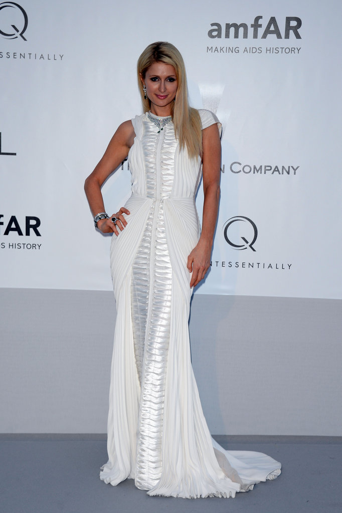 Paris Hilton struck a pose in a white Basil Soda gown that fit her like a glove.
