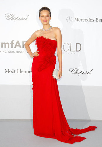 Petra Nemcova was a vision in red at the amfAR gala — to accent the siren look, she toted a slick white clutch.