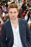 Robert Pattinson gave a sexy smile at the Cosmopolis photocall in Cannes.