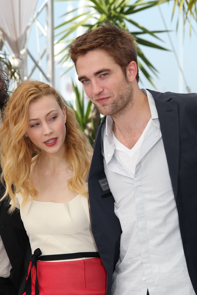 Robert Pattinson laughed with costar Sarah Gadon at the Cosmopolis photocall in Cannes.