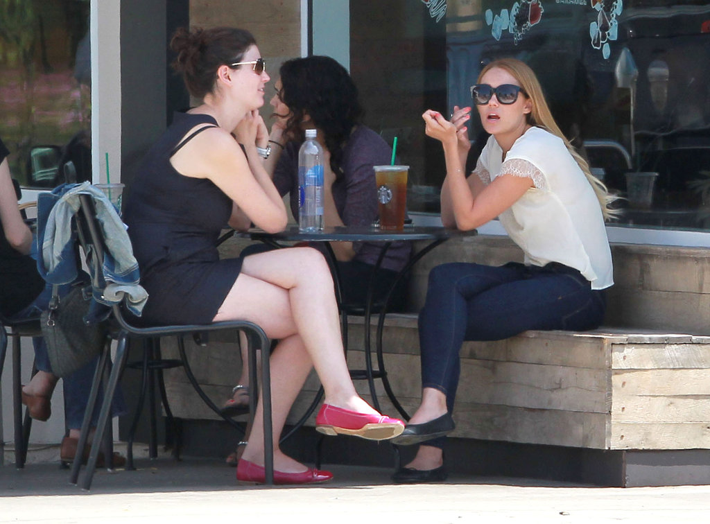Lauren Conrad and a friend sat at a table outside at Starbucks in LA.