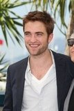Robert Pattinson smiled at the Cosmopolis photocall in Cannes.