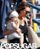 Victoria Beckham carried daughter Harper Beckham at the Santa Monica Pier.