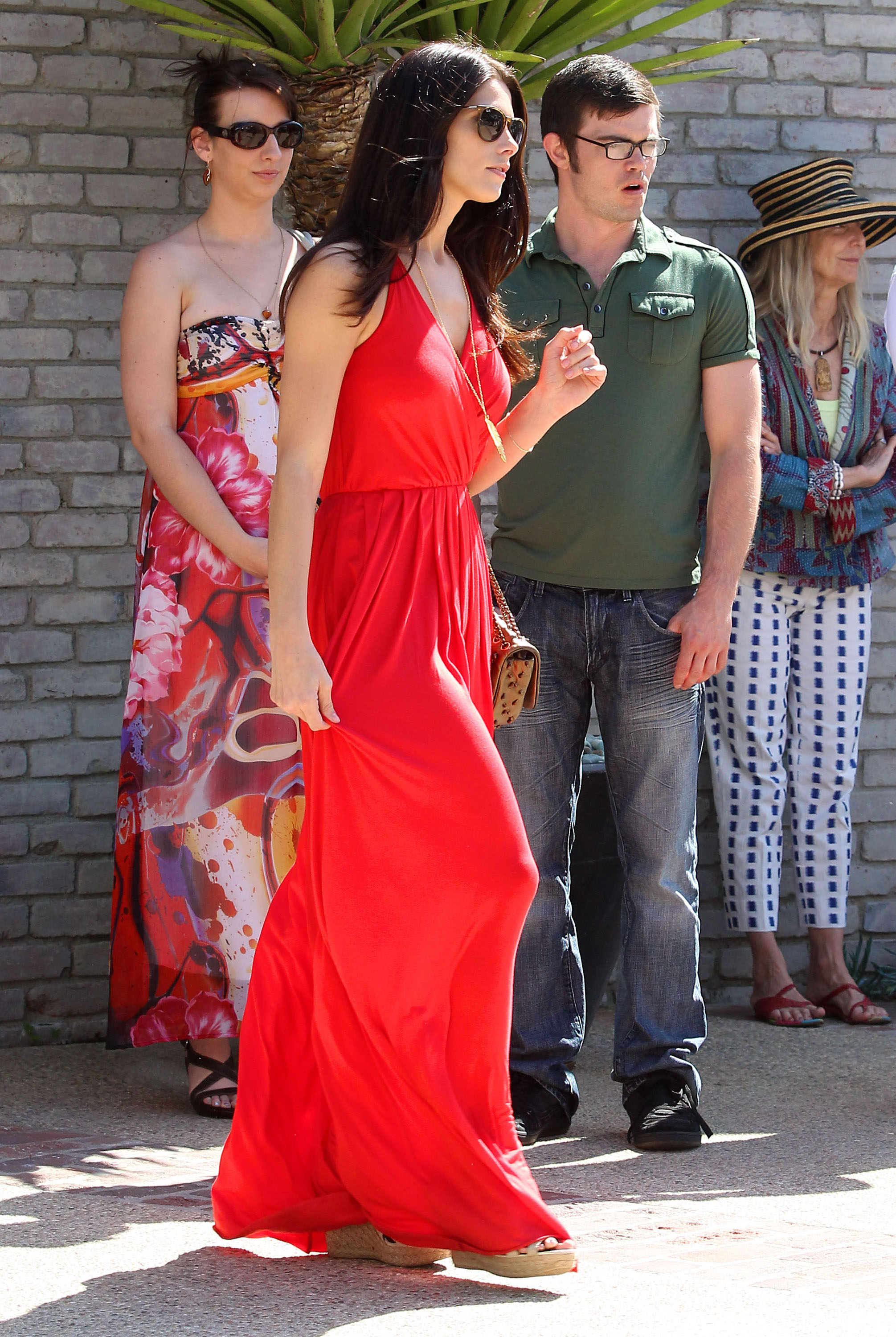 Ashley Greene wore a bright red dress to Joel Silver's Memorial Day party in LA.