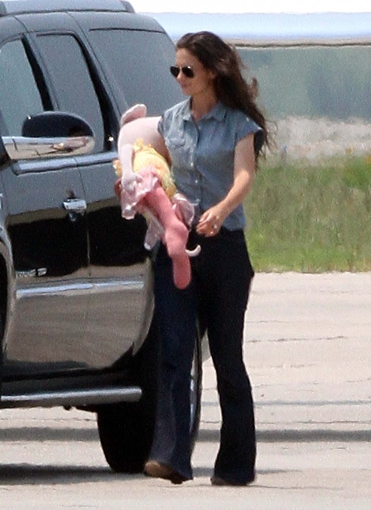 Katie Holmes carried a doll.