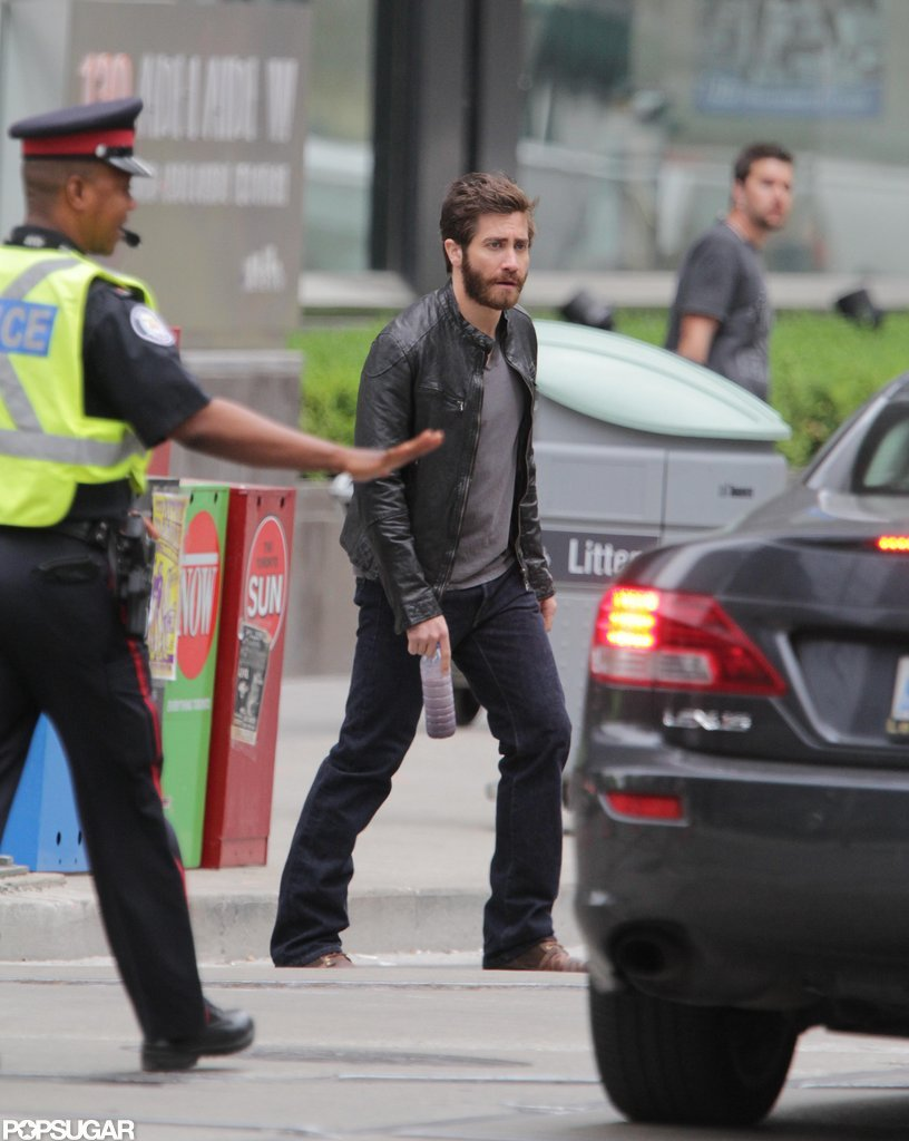 Jake Gyllenhaal crossed a street in Toronto while shooting a scene.