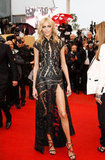 She may be one of the leading pioneers of the thigh-slit movement — Anja Rubik struck a pose in this cap-sleeved laser-cut gown and snake-infused sandals at the Cannes closing ceremony.