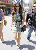 Nina Dobrev's pretty floral dress looks equally chic with bright white flats as it would have with heels — and look how cute and comfortable she looks!