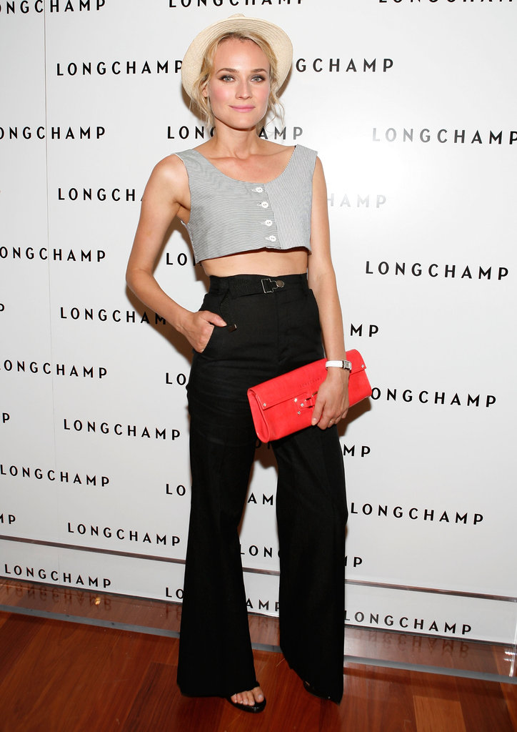 At a Longchamp event in NYC, Diane wore a crop top with high-waisted black trousers and a red clutch, then added a resort vibe via a straw fedora placed on the back of her head. Wear this Forever 21 wide-brim fedora ($15) just like Diane did at your next Summer soiree.