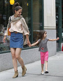 Katie Holmes held tight to Suri Cruise while they walked through the NYC streets.