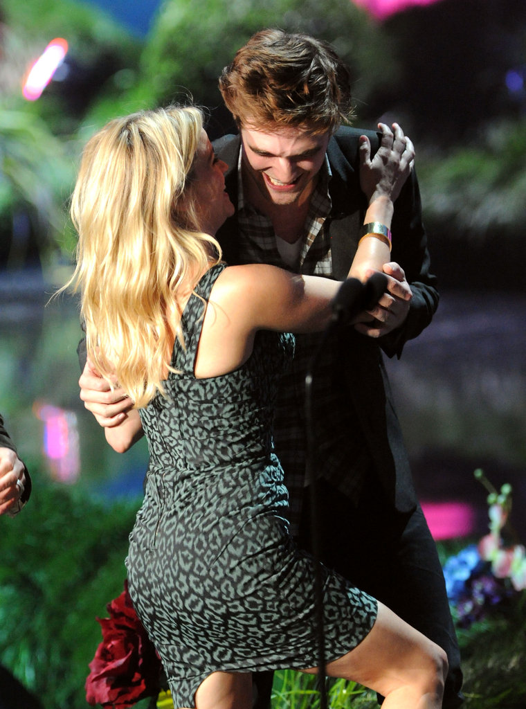 Reese Witherspoon hugged Robert Pattinson after receiving her award in 2011.