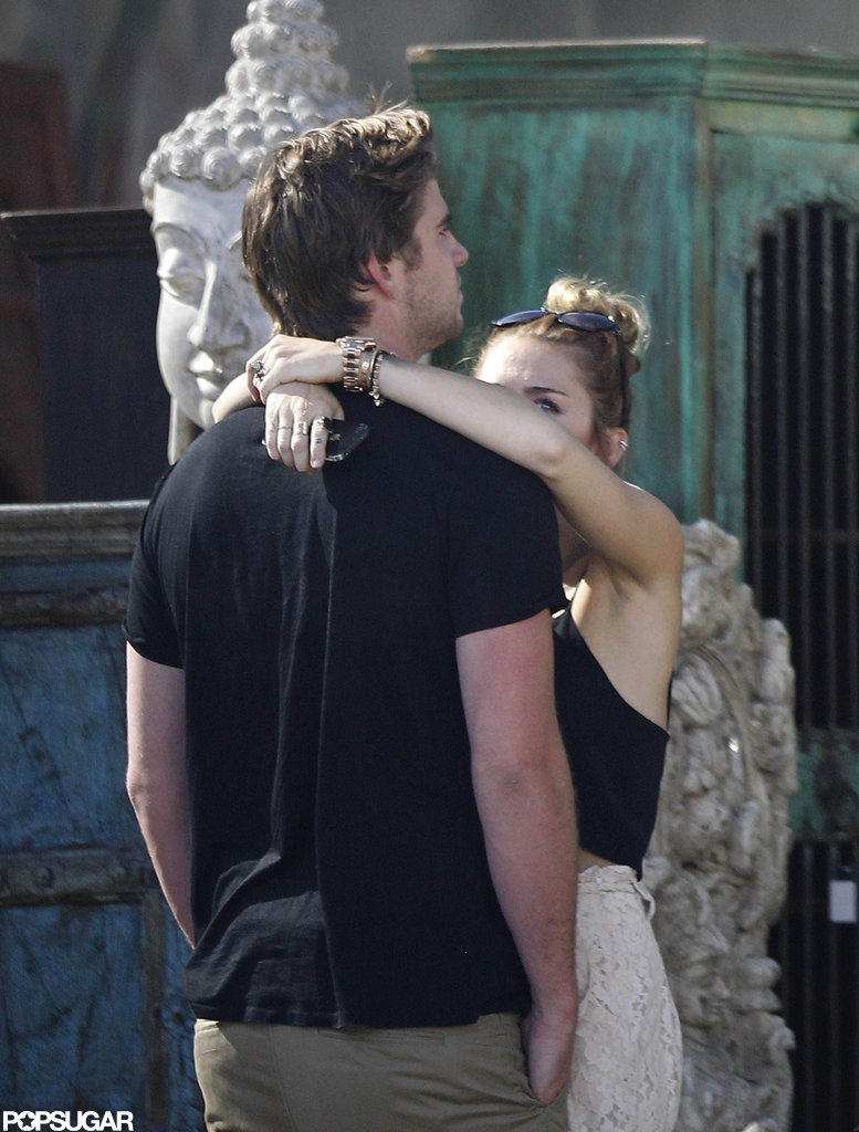 Miley Cyrus hung onto boyfriend, Liam Hemsworth.