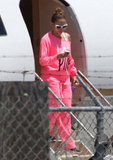 Jennifer Lopez checked her phone while getting off of the plane in LA.