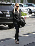 For a day out in LA, Charlize kept it casual and chi with a little help from her Givenchy purse, Dior sandals, and Paul Smith sunglasses.