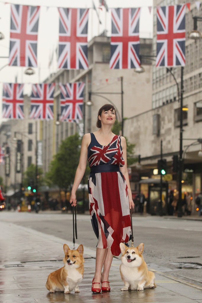 Fashion designer and model Jasmine Guinness posed with Corgis as a part of Oxford Street's Great British Fashion Flag Showcase.