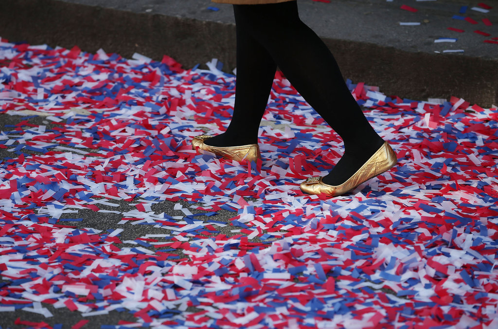 A woman walked through Diamond Jubilee confetti in London.