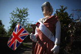 A scarecrow made to look like Queen Elizabeth held a flag in an English village.