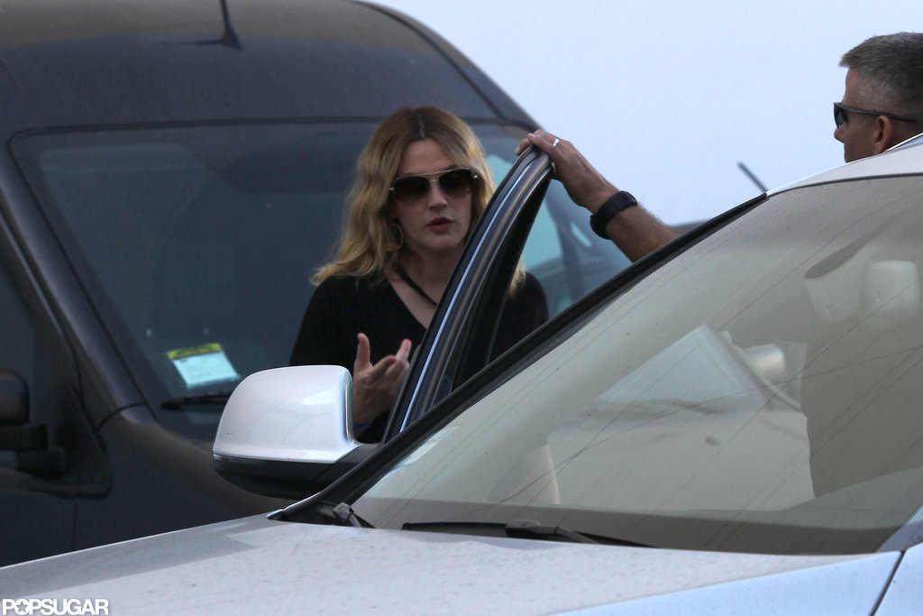 Drew Barrymore got into the car after a final dress fitting in LA. for her upcoming wedding.