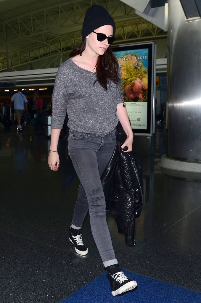 Kristen Stewart arrived in NYC wearing a hood and sunglasses.