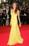 Angelina Jolie wowed in a bright yellow gown at the May 2007 Cannes Fim Festival premiere of Ocean's Thirteen.