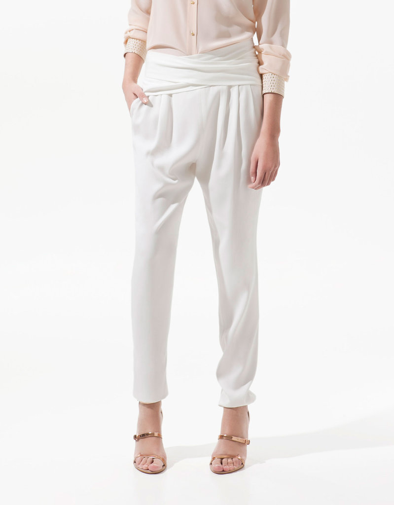"""These silky white trousers are a chic and lightweight option for those days when I don't feel like showing my legs. I'd pair them with a draped tank and sleek sandals for a day at the office."" — Chi Diem Chau, associate editor  Zara Trousers ($80)"