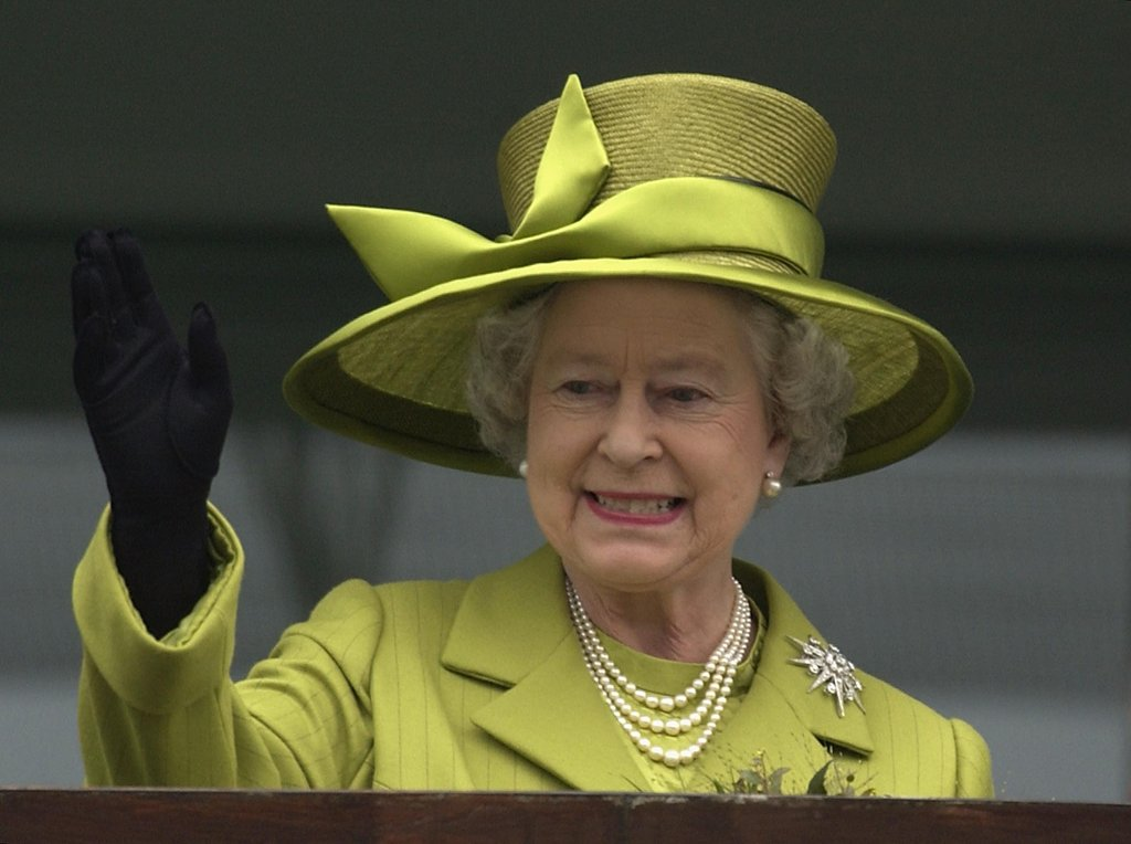 Her Majesty the Queen gave a royal wave in 2002.