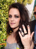 Kristen Stewart showed off her accessorized hand at the MTV Movie Awards.