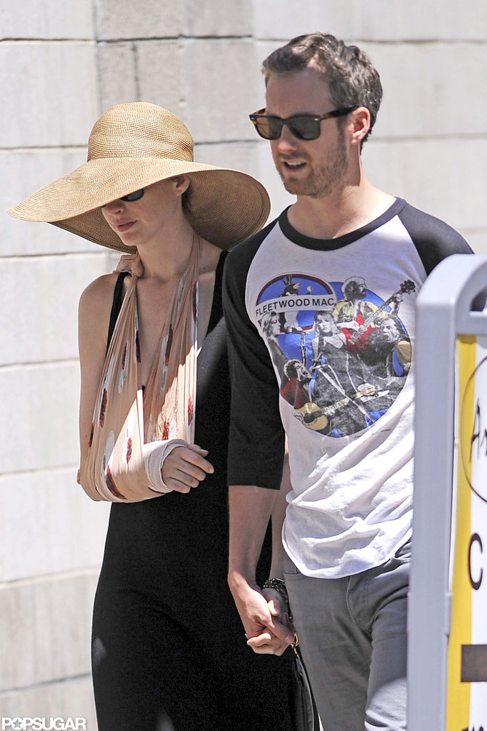 Injured Anne Hathaway Gets a Helping Hand From Her Fiancé