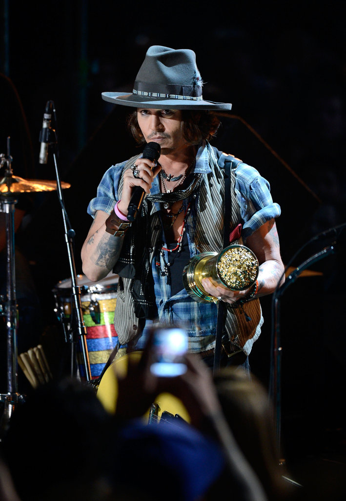 Johnny Depp sang at the MTV Movie Awards.